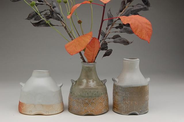 bottles vases stamped soda-fired