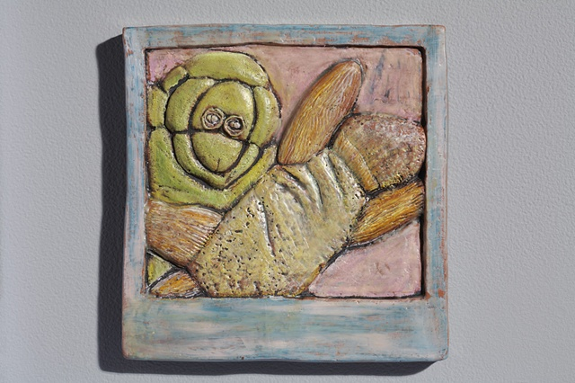 hand cut tile, carved, with encaustic