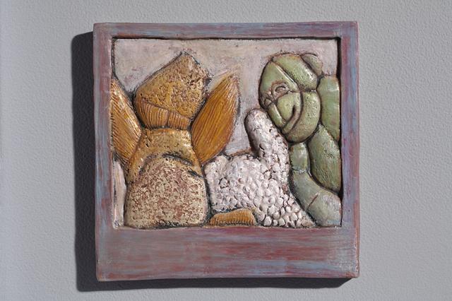 Hand cut tile, carved