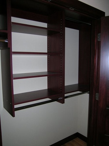 Reach in closet Cherry melamine cabinetry