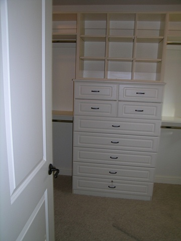 Antique White master bedroom cabinetry