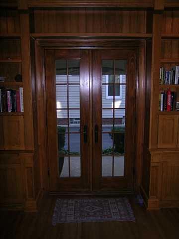 Custom wood cabinetry- both sides of French doors