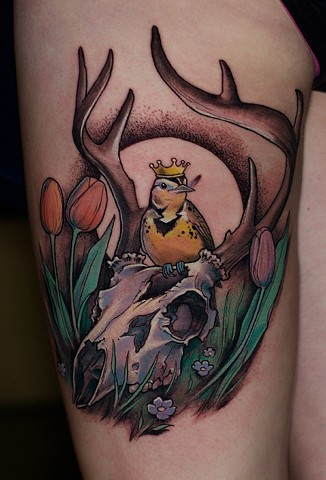 skull with a bird and crown