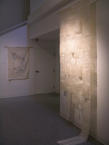 "Install shot of ""Cutting Words: Part 3"" and ""Finding Rhythm in an Archipelago"""