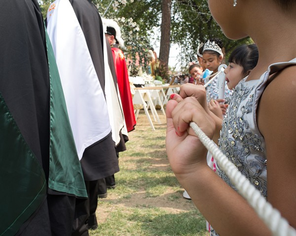 The Knights of Columbus line the flower-petal-mosaic path for the shrines' arrival