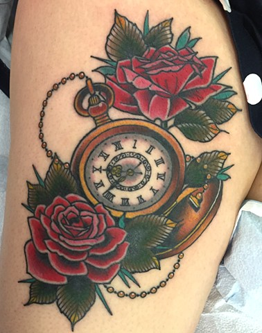 Pocket watch and roses made in Traditional tattoo style with bold colour on leg. Tattooed in Toronto.