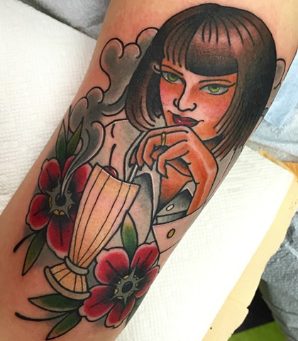 Portrait tattoo of Mia Wallace from Pulp Fiction, done in Traditional style with bold colour. Made in Toronto