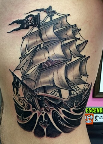 Tall pirate ship in shark infested dark waters, made on the ribs in black and grey tattoo style