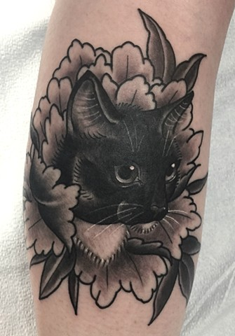 Traditional black and grey cat portrait tattoo, or cattoo, in peony flower, made in Toronto