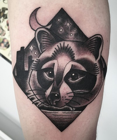 Black and grey traditional raccoon, or trash panda tattoo in a folksy style, depicting Toronto