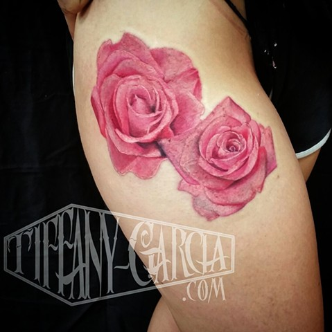 Pink realistic roses by female tattoo Artist Tiffany Garcia