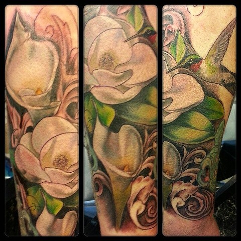 Hummingbird and Lilies by Tiffany Garcia Top Female Tattoo Artist located in Long Beach, Orange County, LA, Huntington Beach, Carson, Palos Verdes, Los Angeles, West Hollywood, Pacific Coast Highway and surrounding areas in Southern California.