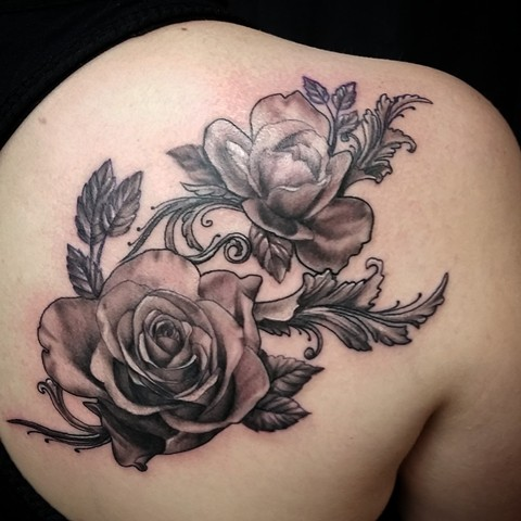 Black and grey roses by Female tattoo artist Tiffany Garcia