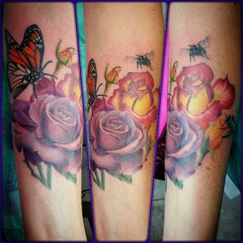 Colorful roses and bumble bees by female tattoo Artist Tiffany Garcia