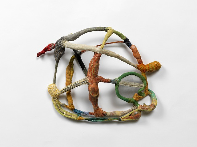 This sculpsture is made from walks around Chicago looking for objects on the street. Using glue, wire, thread and piment I am creating a new life for the debris.