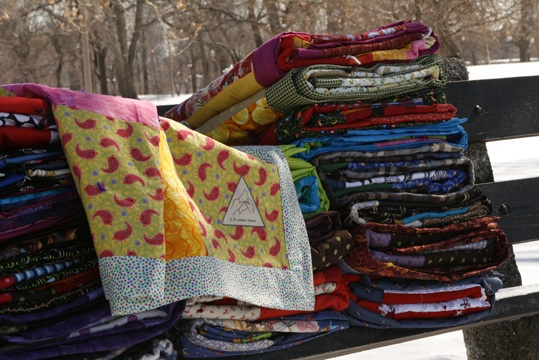quilts on bench