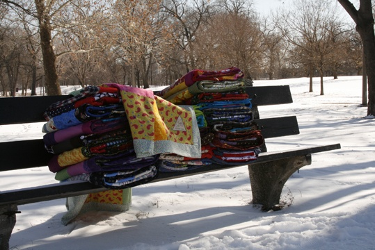 Quilts on a park bench