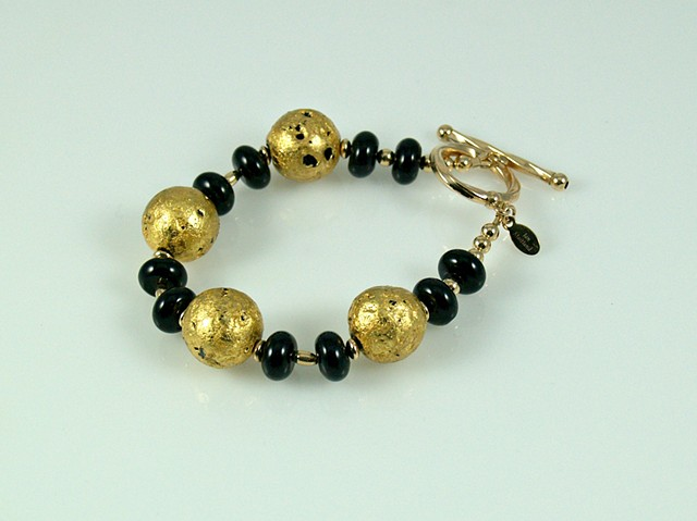 "Bracelet, Gold, Onyx, ""Round We Go"" Bracelet in Onyx and 23-Karat Gold Leaf on Stone"