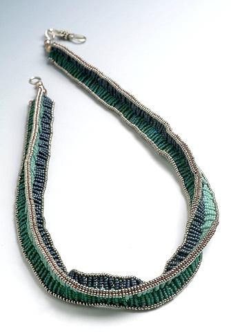 Three legged zulu stitch necklace