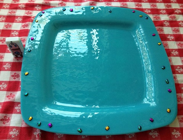 Platter in robins egg blue...  details: 12x12, glass with dichroic glass jewels around edge.