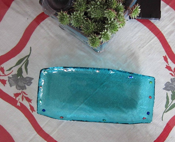 "Little serving tray... Details: 4.5"" wide by 9"" long fused glass with dichroic glass jewels around the edge about 3/4"" deep."
