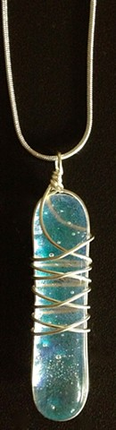 "Artifact #801  details: glass with silver wire wrapped around it...comes on an 18"" silver snake chain"