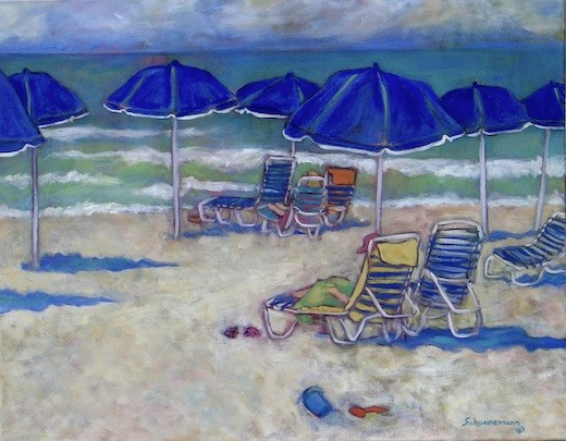 Day at the Beach with Blue Umbrellas