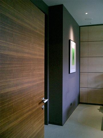Washington Square Loft, Poliform walnut door, modern modern minimalist  bedroom, by Doug Stiles Interior Design