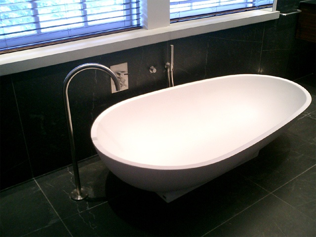 Washington Square Loft, modern minimalist bathroom, agape spoon tub, lefroy brooks XO tub filler, by Doug Stiles Interior Design