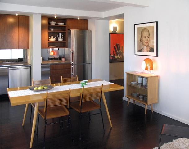 east village prewar apartment, modern kitchen, paul McCobb table chairs, vintage poster Eva Peron, BAM poster, by Doug Stiles Interior Design