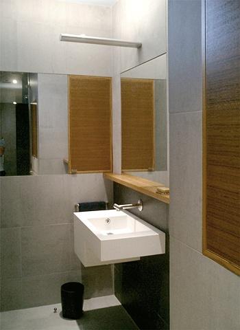 modern minimalist  bathroom, custom aluminum light fixture, walnut medicine cabinet, by Doug Stiles Interior Design