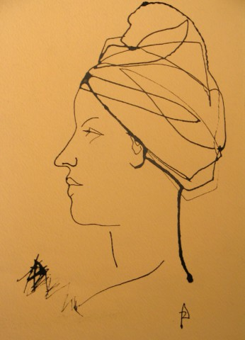 head of a woman with towel wrapped around her head