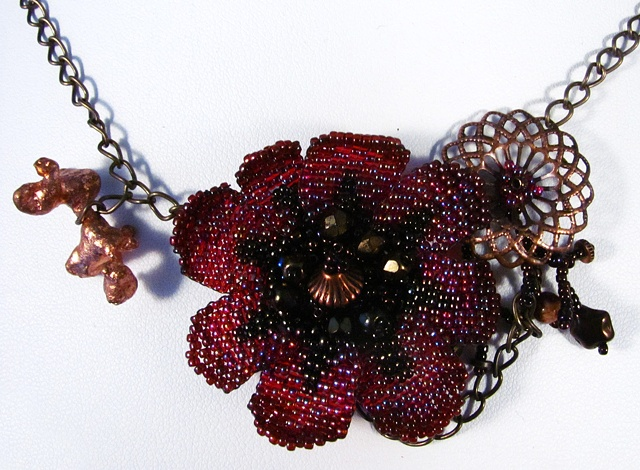 Red and copper steampunk necklace with flower and filigree findings