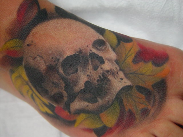 skull with leaves on foot
