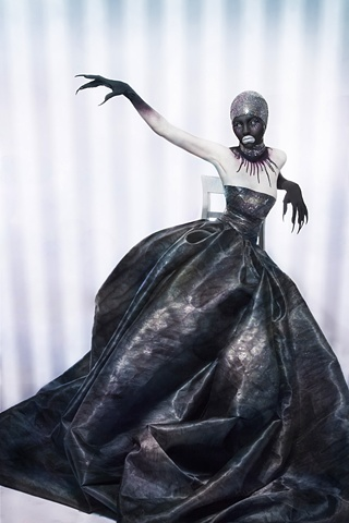 photograph of woman in backface in haute couture gown by christopher andres