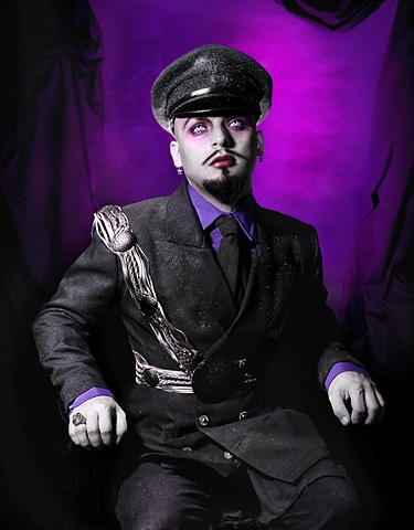 photograph of man in a glittery nazi uniform with lavender eyes by christopher andres