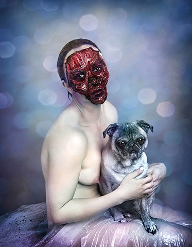 photograph of woman without a face holding a pug by christopher andres