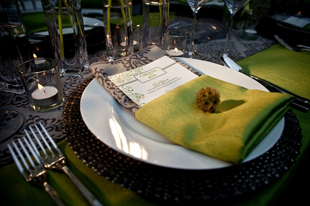 A single scabiosa pod accents a pocket-folded apple green napkin Blue World Studios