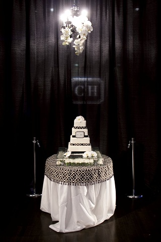 White Phalaenopsis Orchid Stems Hanging From a Black Ornate Chandelier Enhance the Cake Table Display.  Modern - Design Phalaenopsis Orchid Chandelier