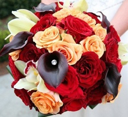I Shot the Bride Bridal Bouquet composed of jewelled purple callas, cymbidium orchids, and red and peach roses.
