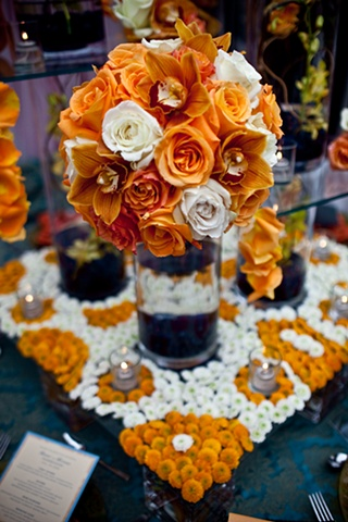 Blue World Studios Modern Tablescape designed on a raised platform of white and orange button mums in a geometric pattern.