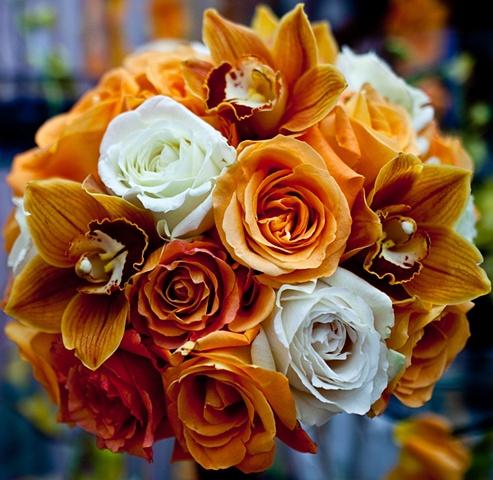 Blue World Studios Orange Bridal Bouquet Bridal Bouquet composed of orange and white roses, and orange cymbidium orchid blooms.