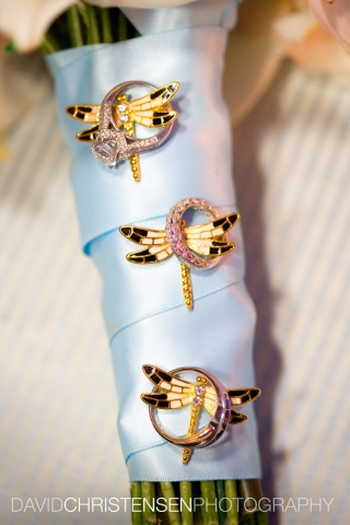 Dragonfly pins accent a hand-tied Bridal Bouquet wrapped with light blue satin ribbon.