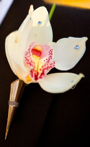 White Cymbidium Orchid Boutonniere accented with light blue jewels.
