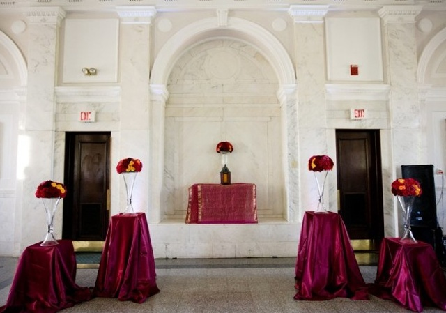 Jamie Howell Photography Old Decatur Courthouse Ceremony Decor Reversible Vase Mounds set on square pedestals of different heights, draped with fuchsia, satin fabric.