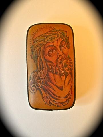 Tattooed leather pillion pad.