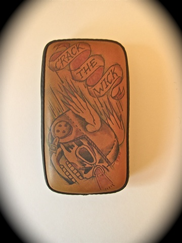 Tattooed leather pillion pad.