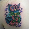 Brittany's girly owl tattoo