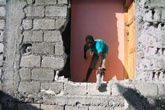 Street kid in rubble, photo from Zanmi Lakay workshop