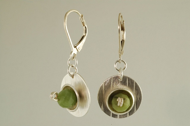 Sculptural sterling silver and Jade nest earrings hang from lever back earring wire
